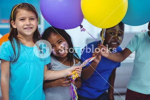 Happy kids playing with balloons