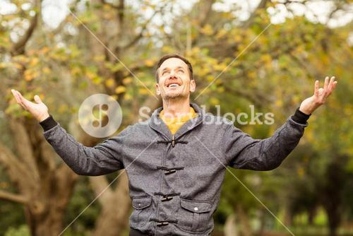 Young handsome man with raised arms