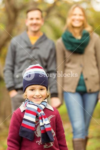 Smiling young family walking together