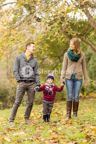 Smiling young couple with little boy laughing