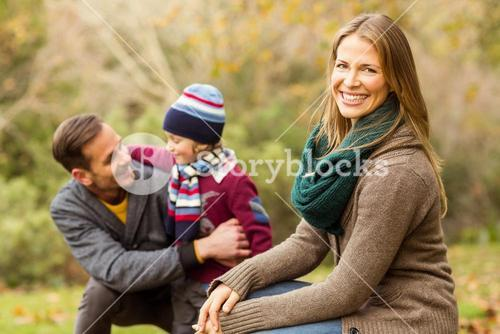 Smiling young couple with little boy posing