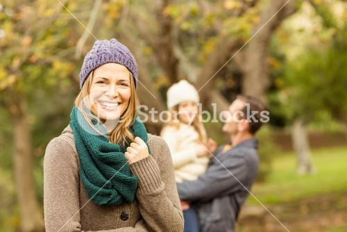 Smiling woman against her husband and her daughter