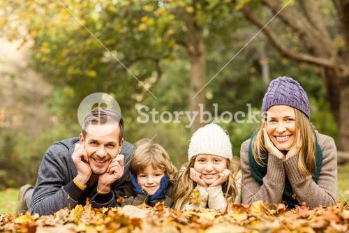 Smiling young family with hands on cheeks