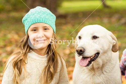 Smiling young girl with her dog