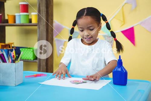 Happy girl making arts and crafts