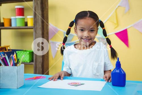 Smiling girl with her arts and crafts