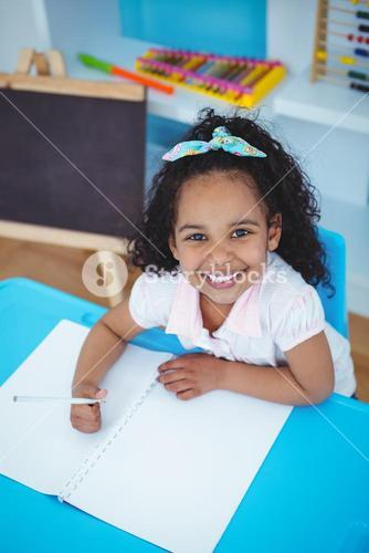 Cute girl writing on notebook