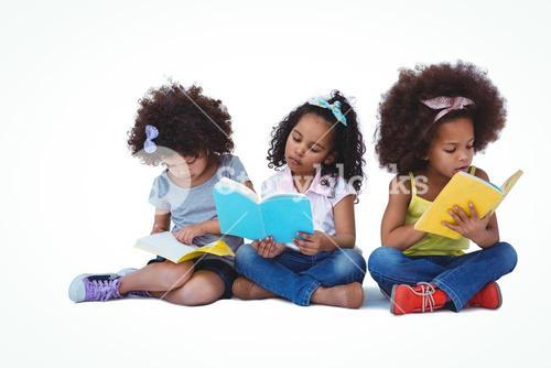 Cute girls sitting on the floor reading books