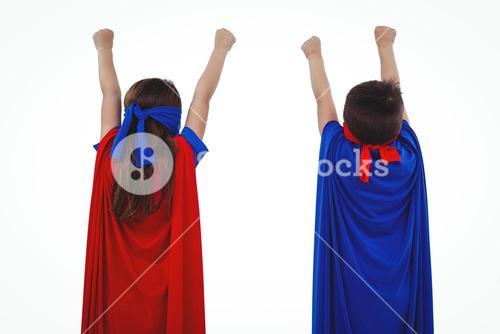 Masked kids pretending to be superheroes