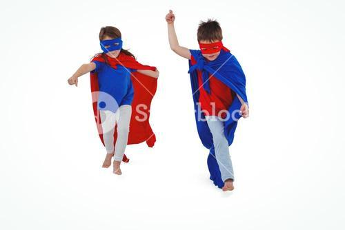 Masked kids walking pretending to be superheroes