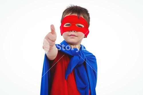 Masked boy pretending to be superhero