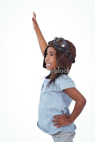 Side view of girl with outstretched arm pretending to be pilot