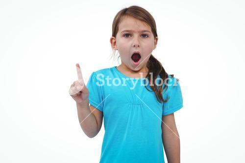 Cute girl shaking finger saying no to the camera