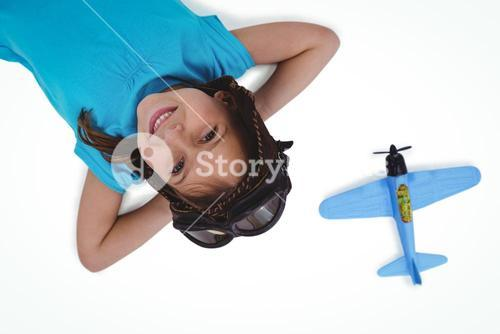 Smiling girl laying on the floor