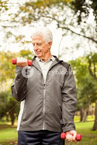 Senior man working out in park