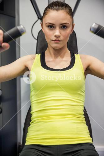 Woman using the weights machine