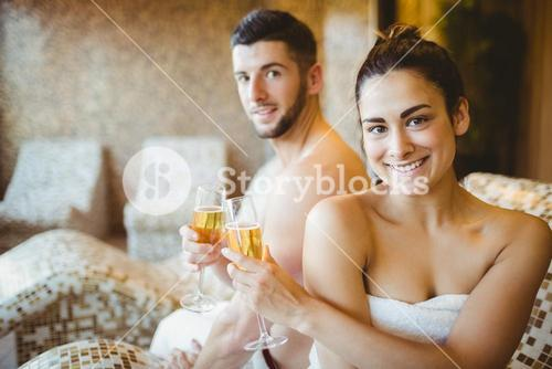 Happy couple celebrating with champagne