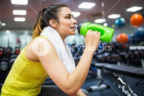 Woman taking a drink from her water bottle
