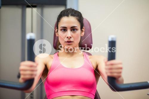 Determined woman working out