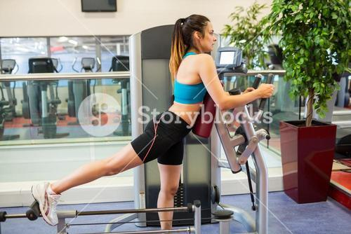 Woman on a weights machine for her legs