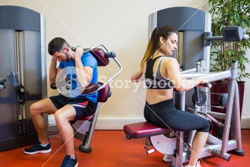 Fit man and woman working out