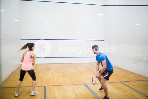 Couple play some squash together
