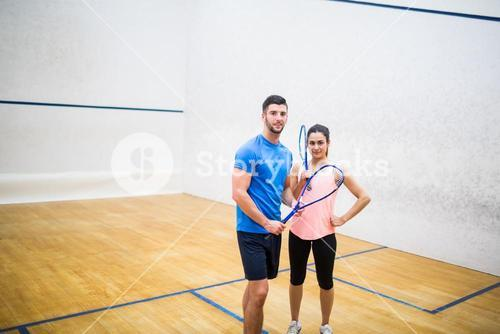 Happy couple after a squash game
