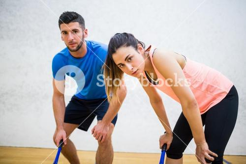 Couple tired after a squash game