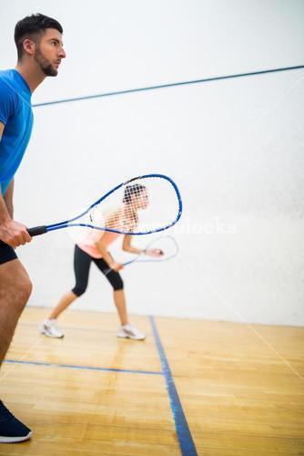 Woman about to serve the ball