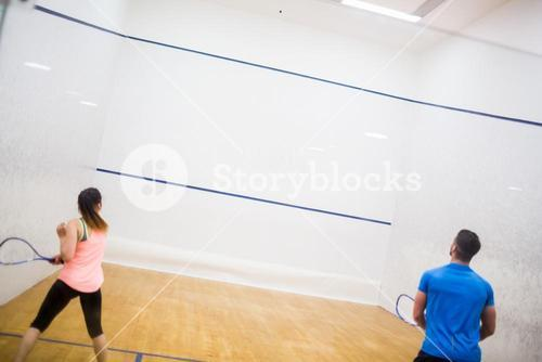 Couple enjoying a game of squash