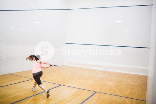 Woman playing a game of squash
