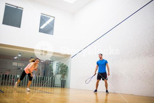 Couple playing a game of squash