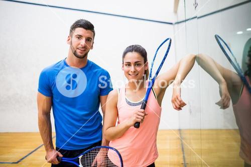 Happy couple about to play squash