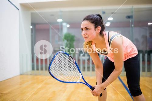 Woman eager to play squash