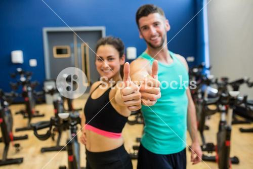Focused couple giving thumbs up