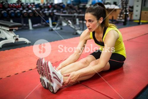 Woman doing warm up exercises