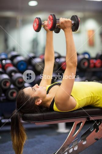 Woman working out with weights