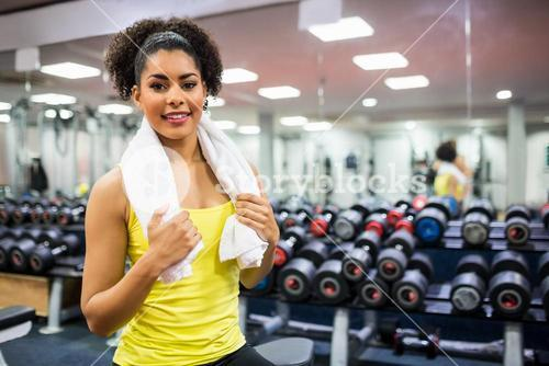 Fit woman working out in weights room