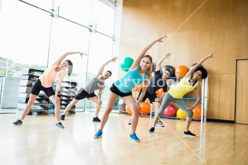 Fitness class exercising in the studio