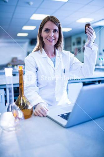 Scientist working with a laptop in laboratory