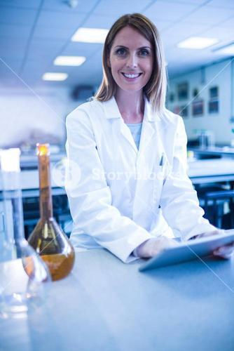Scientist working with a tablet in laboratory