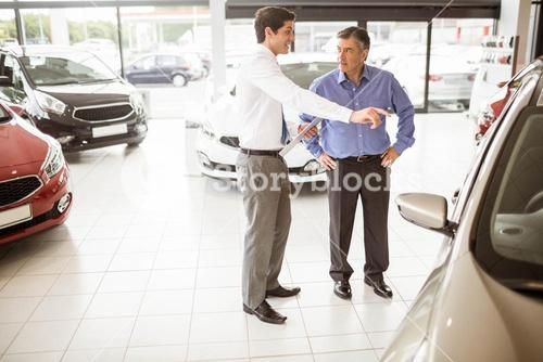 Salesman showing somethings to a man