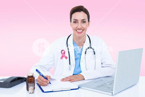 Composite image of portrait of smiling female doctor writing on pad
