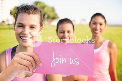 Join us against three smiling women wearing pink for breast cancer