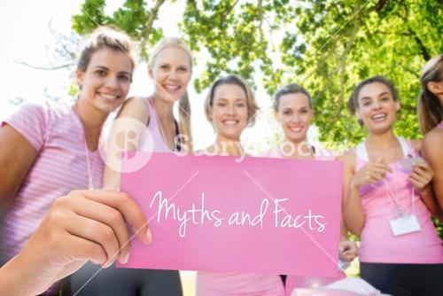 Myths and facts against smiling women organising event for breast cancer awareness