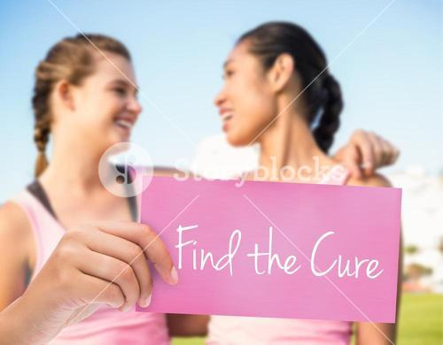 Find the cure against two smiling women wearing pink for breast cancer