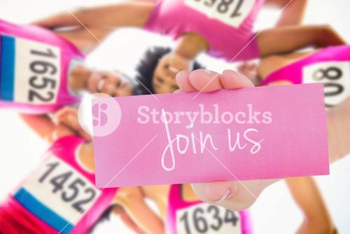 Join us against five smiling runners supporting breast cancer marathon
