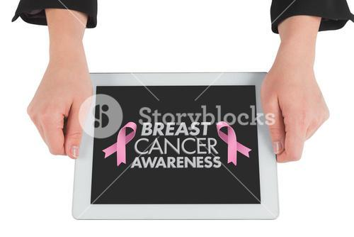 Composite image of businesswomans hands holding tablet