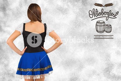 Composite image of oktoberfest girl standing with hands on hips