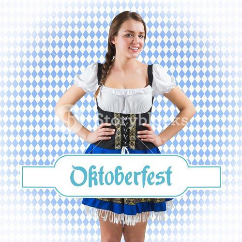 Composite image of pretty oktoberfest girl with hands on hips